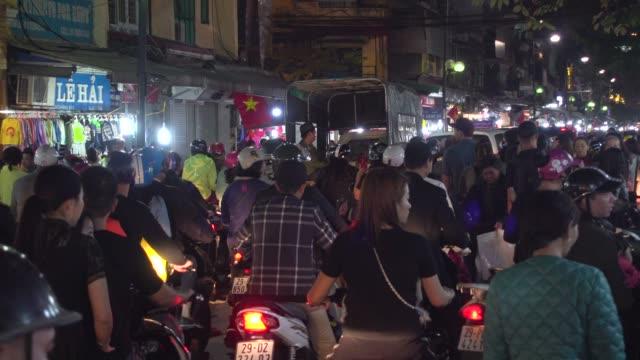 hanoi night market street full of motorcycles. hoan kiem old quarter district - north vietnam stock videos & royalty-free footage