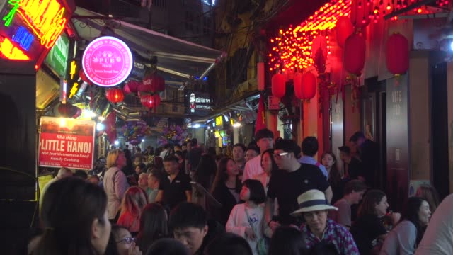 hanoi old quarter nightlife. narrow illuminated crowded street at night. hoan kiem old town district - middle class stock videos & royalty-free footage