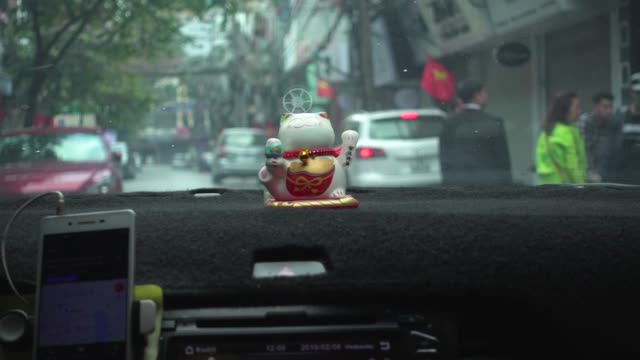 hanoi vietnam from a taxi or car ridesharing pov. maneki neko figurine - newly industrialized country stock videos and b-roll footage