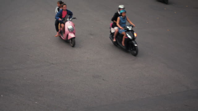 hanoi vietnam road directly above. traffic high angle view. motorbikes and cars directly above - north vietnam stock videos & royalty-free footage