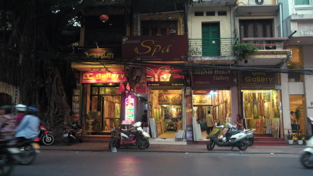 hanoi vietnam street with art gallery shops at sunset - traditionally vietnamese stock videos & royalty-free footage