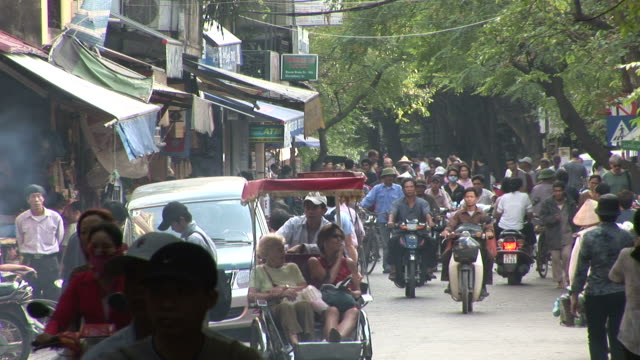 hanoi, vietnamview of a crowded city street in hanoi vietnam - hanoi stock videos and b-roll footage