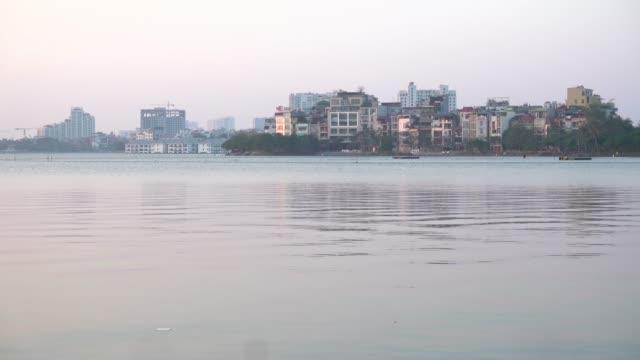 hanoi west lake houses skyline. vietnam establishing shot - newly industrialized country stock videos & royalty-free footage