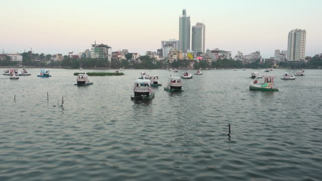 hanoi west lake. swan shaped boats tour. vietnam establishing shot - newly industrialized country stock videos & royalty-free footage