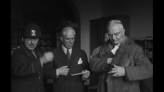 hans fritzsche and former german chancellor franz von papen inside courtroom holding documents after their acquittal at the nuremberg trials / dr... - processi di norimberga video stock e b–roll