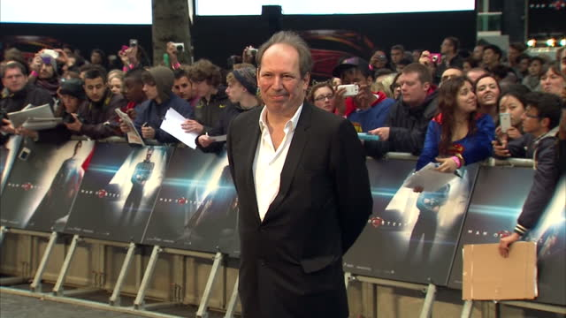 Hans Zimmer signing autographs and posing for photo op on red carpet of new Superman film Man Of Steel in Leicester Square Hans Zimmer walks red...