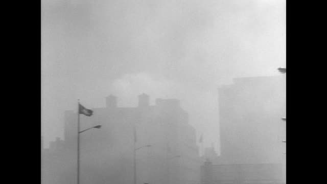 ss hanseatic german ocean liner burns at hudson river pier in new york / liner at harbor with smoke billowing into the sky / new york skyline as seen... - 救助隊点の映像素材/bロール