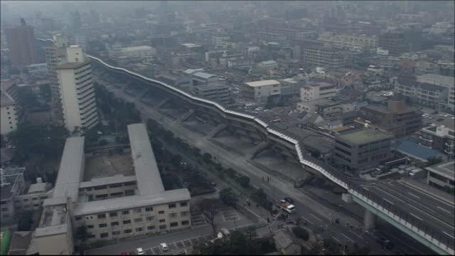 hanshin express highway toppled sideways. tracking shot. aerial shot. - 地震点の映像素材/bロール
