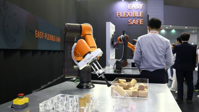 a hanwha techwin co robotic arm transports pieces of wood during a demonstration at the robotworld 2017 industry show in goyang south korea on... - goyang stock videos and b-roll footage