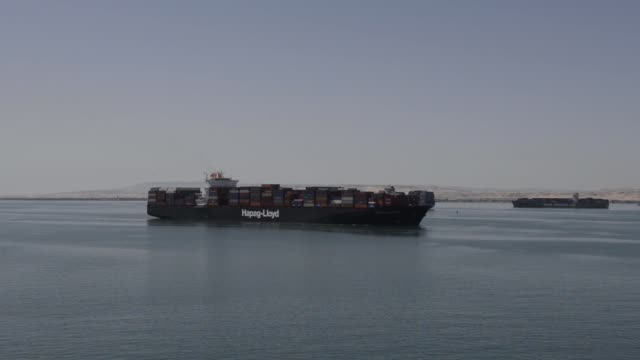 hapag-lloyd ag container ship is seen from the ebba maersk container ship, operated by a.p. moeller-maersk a/s, as it arrives in suez after passing... - suez canal stock videos & royalty-free footage