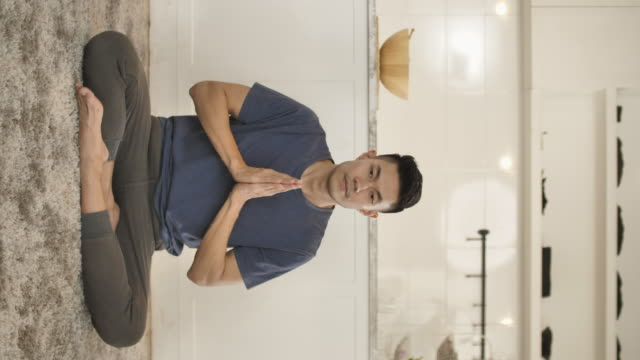 happiest  yoga man portait - lotus position stock videos & royalty-free footage