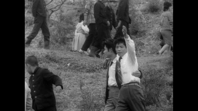 happily drunk man at cherry blossom festival; 1962 - suit stock videos & royalty-free footage