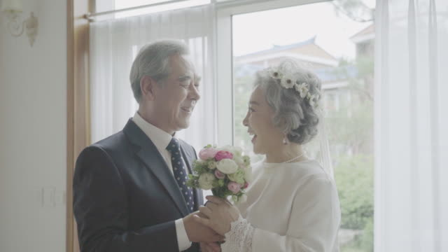 a happily senior couple in remind wedding - south korea couple stock videos & royalty-free footage