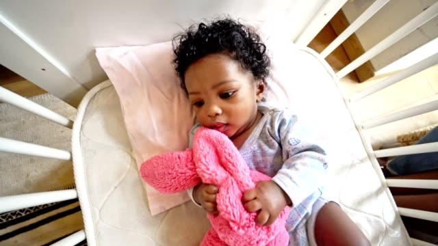 happiness african kid in the crib - security blanket stock videos & royalty-free footage