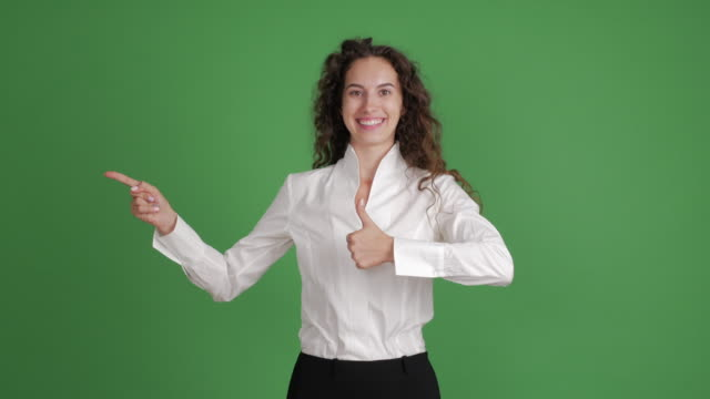 happiness businesswoman showing copy space on green background - blouse stock videos & royalty-free footage