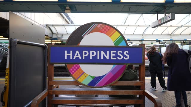 """happiness"""" by dan vo, museum educator at hammersmith london underground station at tfl installs new equality signs across london underground tube... - business finance and industry stock videos & royalty-free footage"""