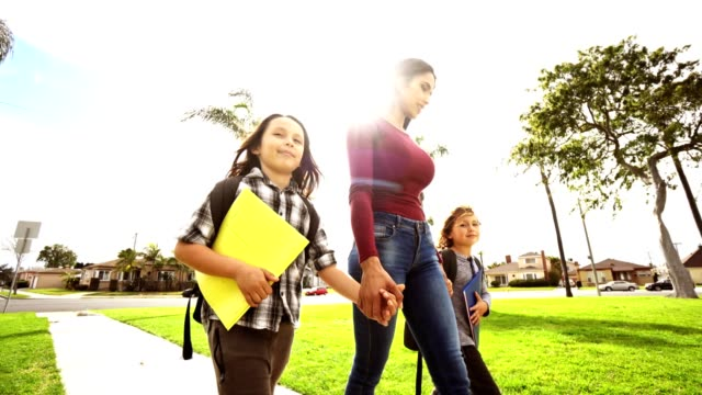 happiness family walking in the park after school - one parent stock videos & royalty-free footage