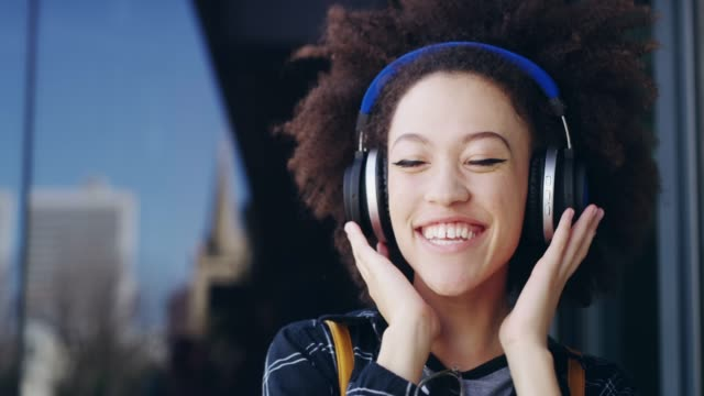 happiness is just a song away - headphones stock videos & royalty-free footage