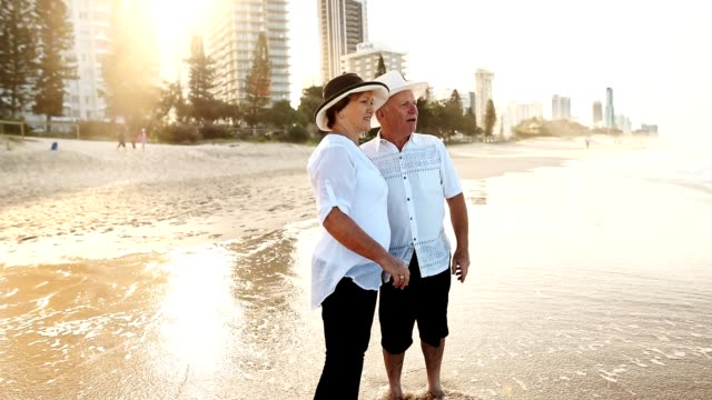happiness senior couple embracing lovely at dusk - senior couple stock videos & royalty-free footage