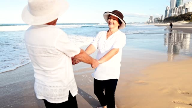 happiness senior couple embracing lovely at dusk - falling in love stock videos & royalty-free footage