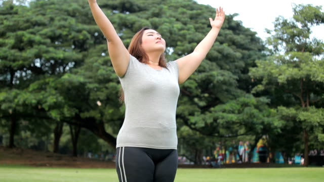 Happy a woman posing outdoor