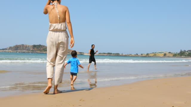 happy aboriginal australian family at the beach - two parents stock videos & royalty-free footage