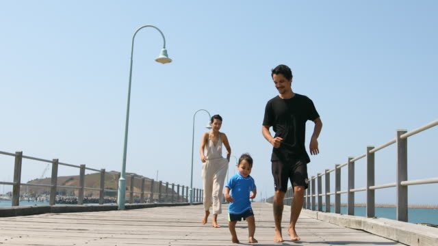happy aboriginal australian family on a pier - australian aboriginal culture stock videos and b-roll footage