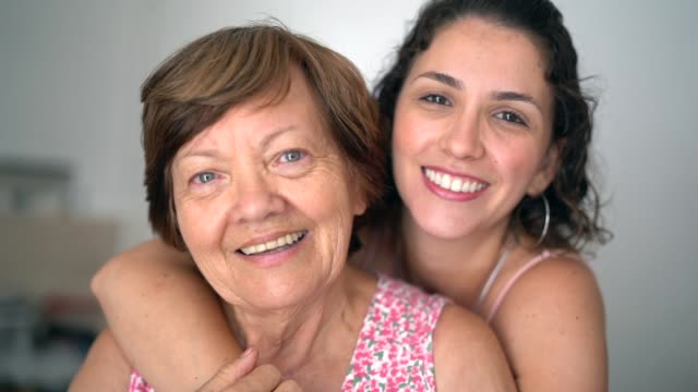 happy adult mother and daughter embracing - gente comune video stock e b–roll