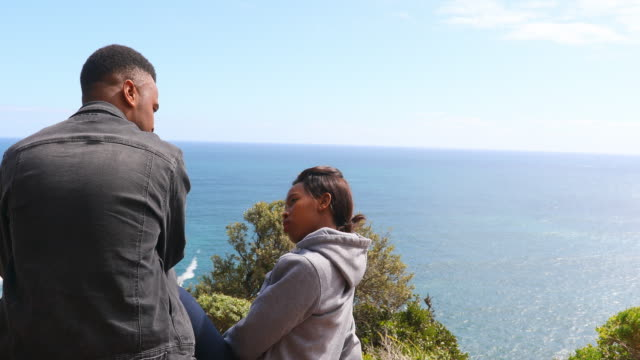 Happy African Couple Talking While Looking at the Ocean View