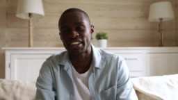 Happy african man looking at camera talking laughing video calling