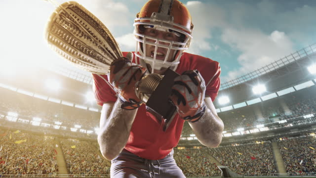 happy american football player - uniform stock videos & royalty-free footage