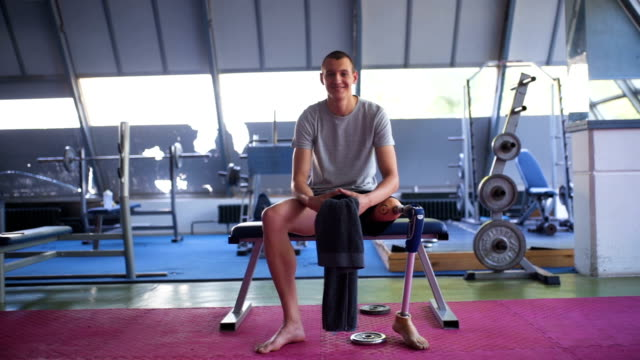 happy amputee athlete at the gym - amputee stock videos & royalty-free footage