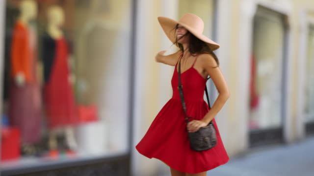 happy and attractive female modeling red sundress outside - sundress stock videos & royalty-free footage