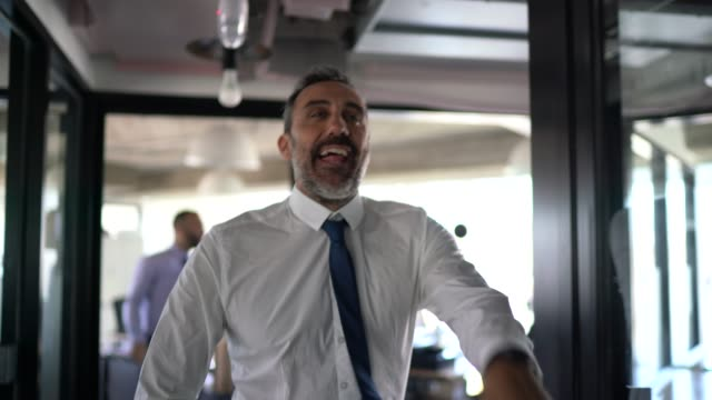 happy and confident businessman dancing in the office - joy stock videos & royalty-free footage