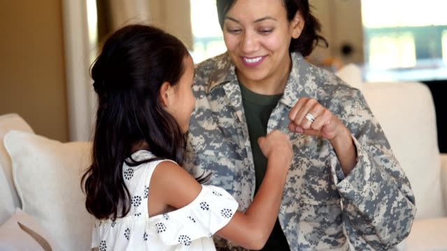 happy army mom is reunited with adorable daughter - single parent family stock videos & royalty-free footage