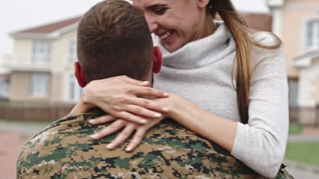 happy army wife reuniting with husband - arrival stock videos & royalty-free footage