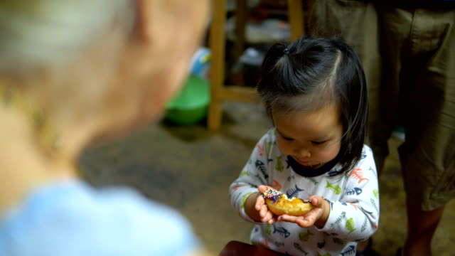 happy asian baby girl eating food at home. - solid stock videos & royalty-free footage