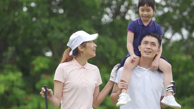 happy asian chinese couple golfer with their daughter having bonding time at golf course - t shirt stock videos & royalty-free footage