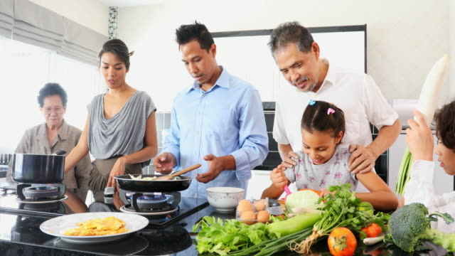 happy asian family cooking together in the kitchen - thai ethnicity stock videos & royalty-free footage