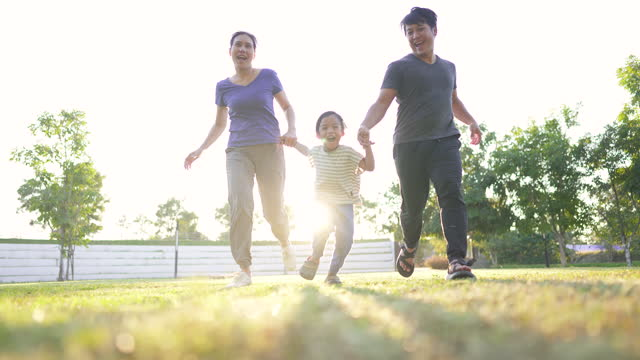 happy asian family running to camera - sunny stock videos & royalty-free footage