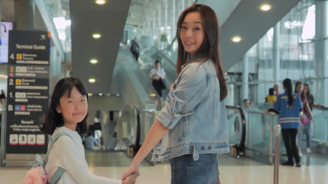 happy asian family smiling in the airport.travel,journey,global,lifestyle,holidays,technology concept.south east and east asia: at the airport - east asian ethnicity video stock e b–roll