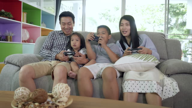 vídeos de stock e filmes b-roll de happy asian family spend times for relaxing together - jogo de lazer