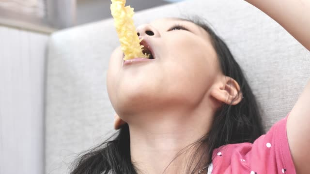 happy asian girl eating japanese food with family together in restaurant, lifestyle concept. - tendon stock videos & royalty-free footage