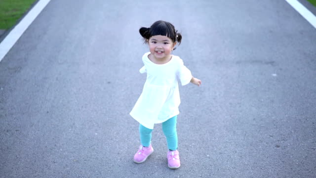 slomo happy asian girl jumping and clapping - baby girls stock videos & royalty-free footage