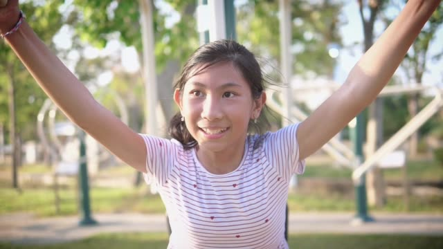 happy asian girl using exercise equipment in the park outdoor, slow - moulding trim stock videos & royalty-free footage