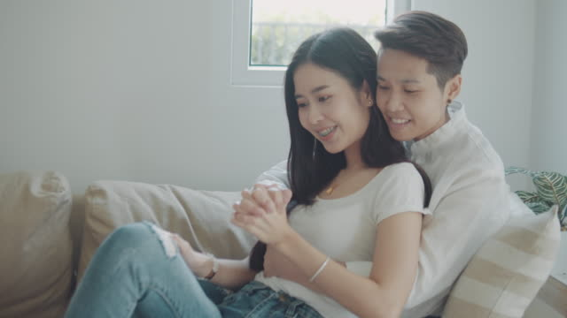 happy asian lesbian at home. - hugging self stock videos & royalty-free footage