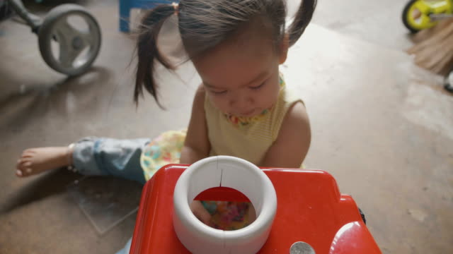 a happy asian little beautiful girl enjoy playing toy on the floor , 2 year old. concept of happiness ,energy, playful. - one baby girl only stock videos & royalty-free footage