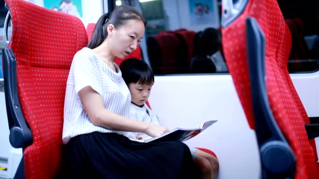 happy asian mother and son take the subway - public transport stock videos & royalty-free footage