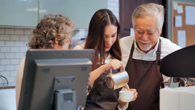 happy asian multi generation family working in cafe shop after the covid-19 emergency, ended the lockdown and quarantine.the growing small business,family business, multi generation family, entrepreneurship, retirement, service, seniorpreneurs,elderly - barista stock videos & royalty-free footage