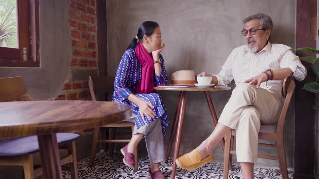 happy asian senior couple enjoy drinking coffee at coffee shop cafe, senior couple relaxing and spending time together at restaurant, people lifestyle concept - indian couple tea stock videos & royalty-free footage